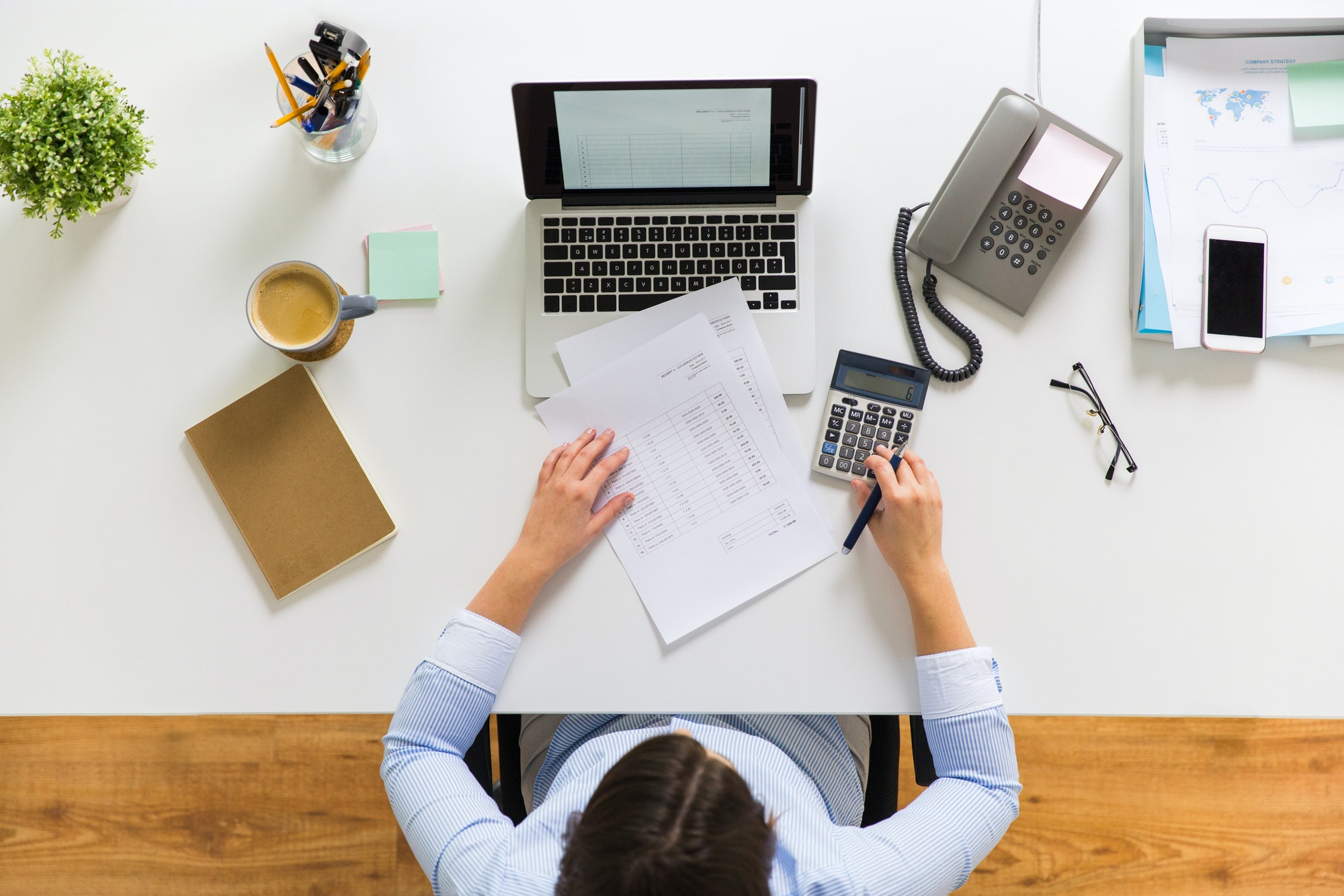 businesswoman with tax report at office